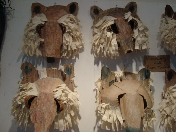 Bear masks on gallery wall