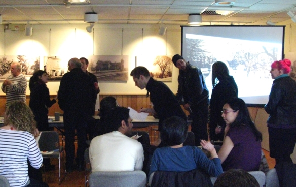Artists and community workers mingle after the discussion.