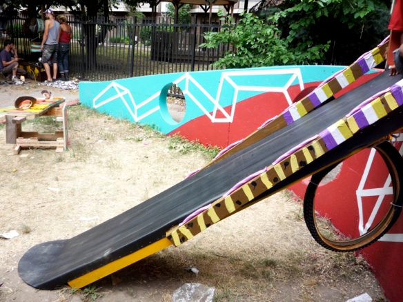 A slide created with found and recycled materials by the Youth Street Art Mentorship project.